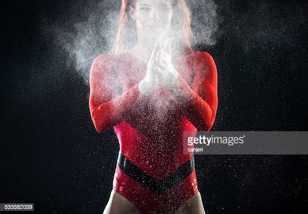 Young woman preparing for gymnastics exercise