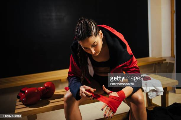 young woman preparing for the muay thai workout - muay thai stock pictures, royalty-free photos & images