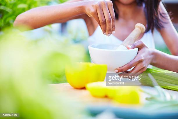 Young woman preparing healthy meal in garden