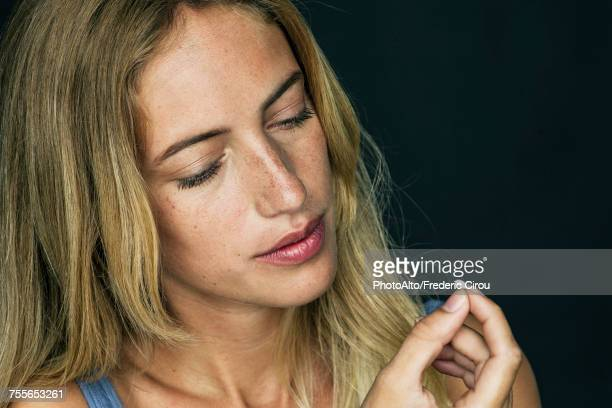 Young woman preparing to take pill