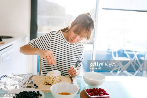 Young woman preparing vegan cake