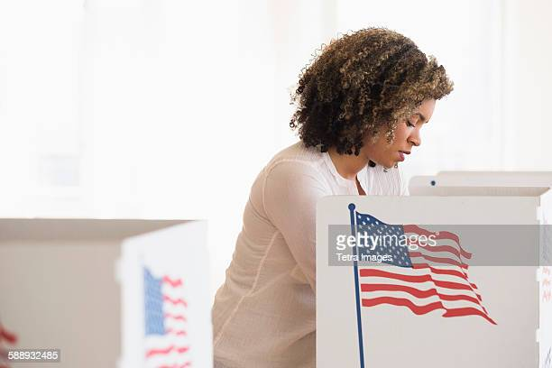 young woman preparing voting booth - votes for women stock photos and pictures