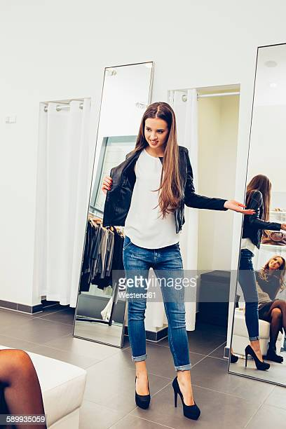 Young woman presenting new clothes in a boutique