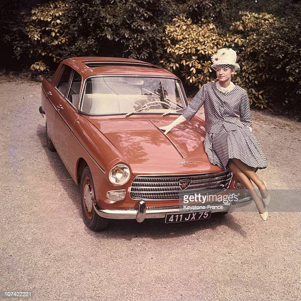 Young Woman Presenting The New Peugeot 404 In France On 1960