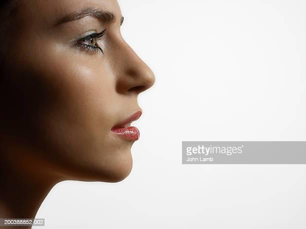 young woman, profile, close-up - junge frau allein stock-fotos und bilder