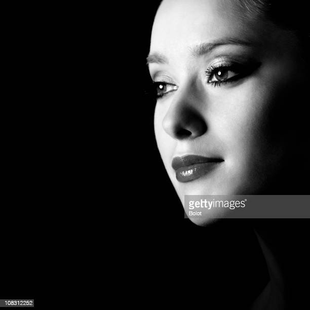 young woman profile portrait against black background - human head stock pictures, royalty-free photos & images