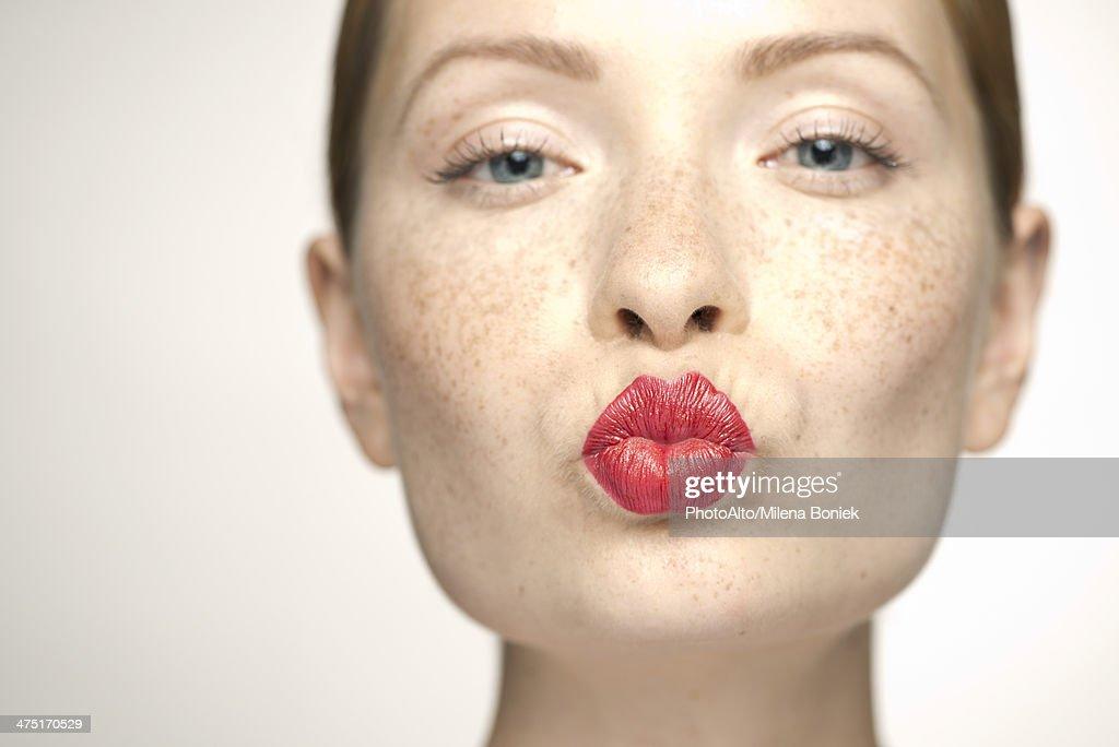 Puckering of lips