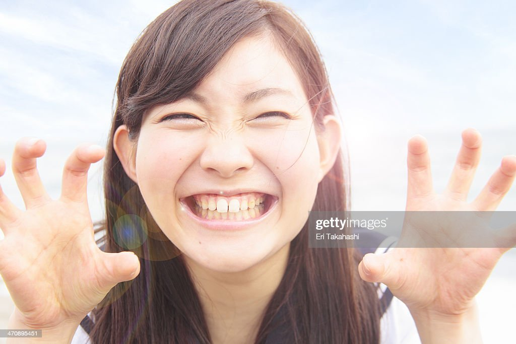 Young woman pulling funny face and hands like claws : Stock Photo