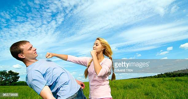 Young woman punching young man