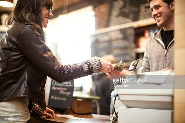 young woman purchasing coffee - cash register stock pictures, royalty-free photos & images