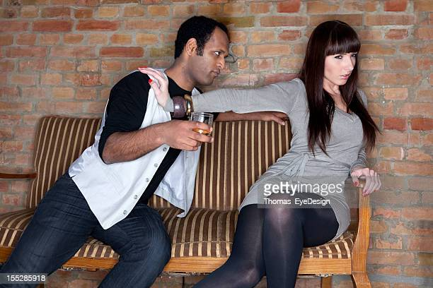 Young Woman Pushing Away a Drunk Man.
