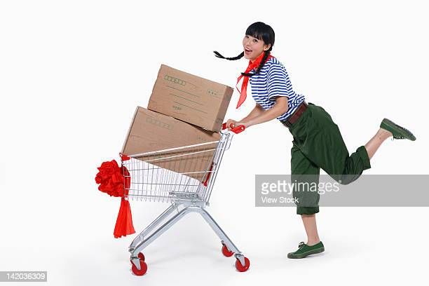 Young woman pushing shopping cart