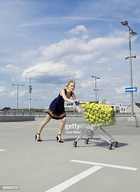 young woman pushing shopping cart
