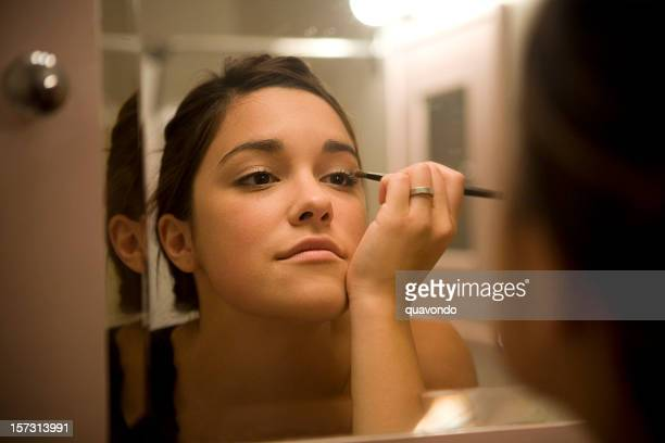 Applying Make Up in Bathroom Mirror, Beautiful Brunette Young Woman