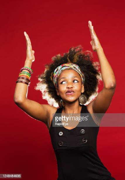 young woman raises her arms with a zany expression on her face - bracelet stock pictures, royalty-free photos & images