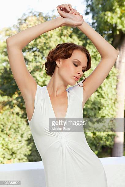 Young woman raising arms