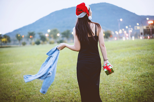 A young woman ran freely along the outdoor lawn. 1058652692