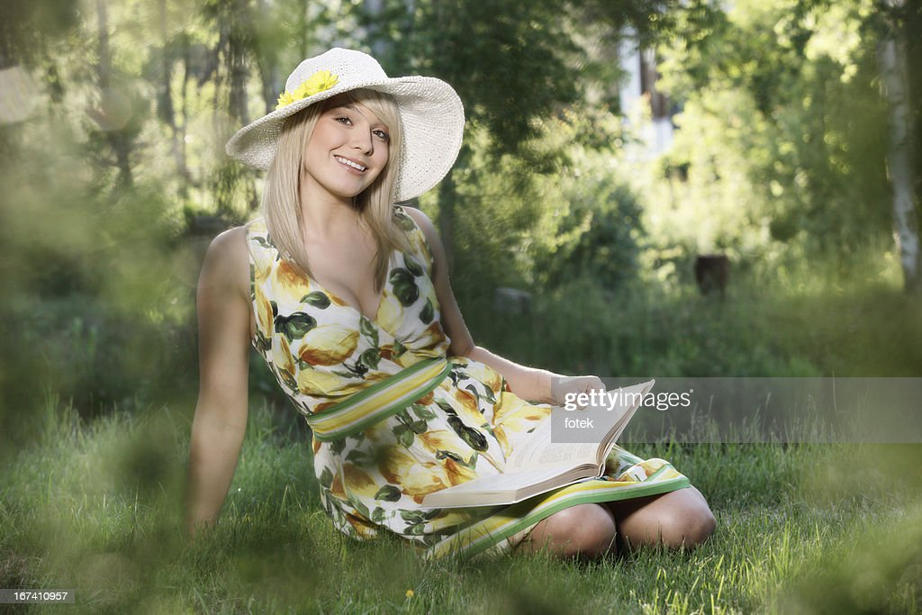 Young woman reading a book : Stock Photo