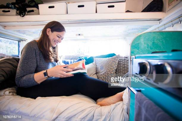 Young woman Reading in Camper