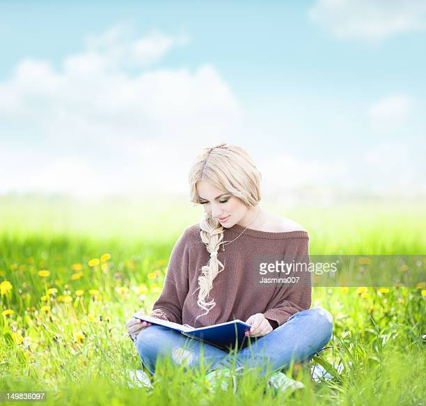 Young woman reading in the nature