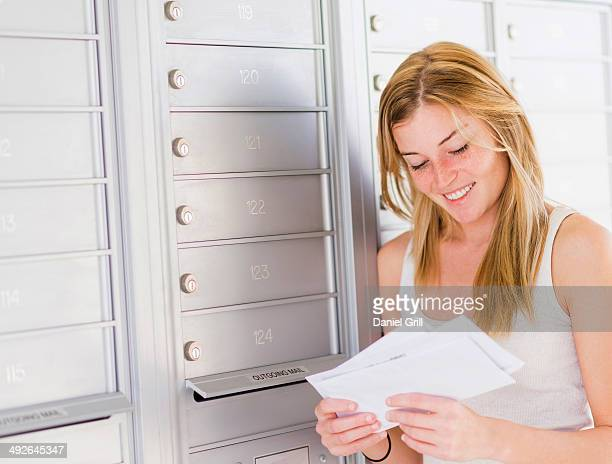 Young woman reading letters, Jupiter, Florida, USA