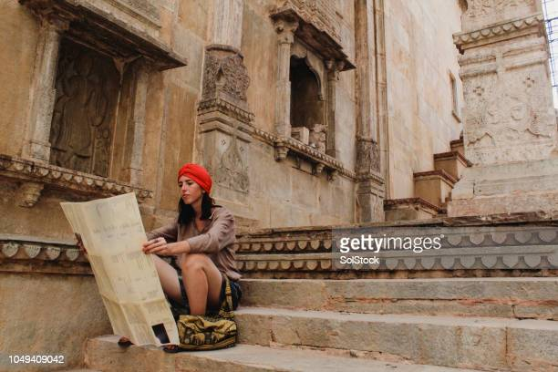 young woman reading map in bundi temple - historical geopolitical location stock photos and pictures