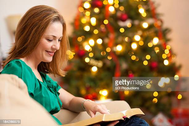 Young Woman Reading The Bible at Christmas Time
