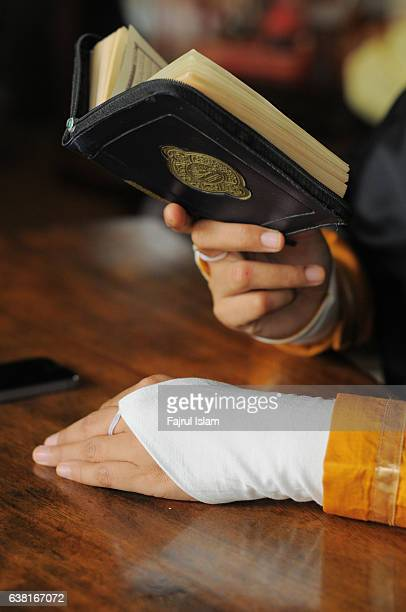 Young woman reading the Koran at cafe