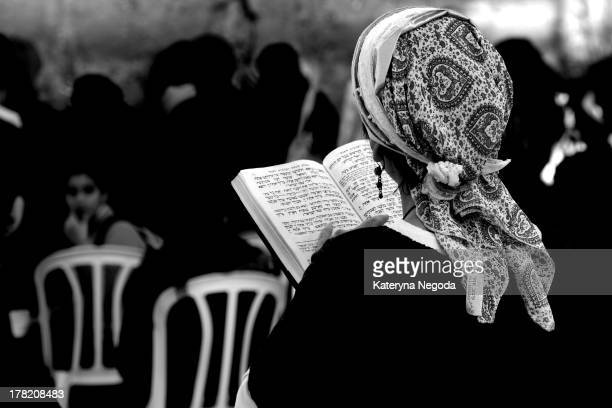 CONTENT] Young woman reading torah book by Wailing Wall The Western Wall Wailing Wall or Kotel is located in the Old City of Jerusalem at the foot of...