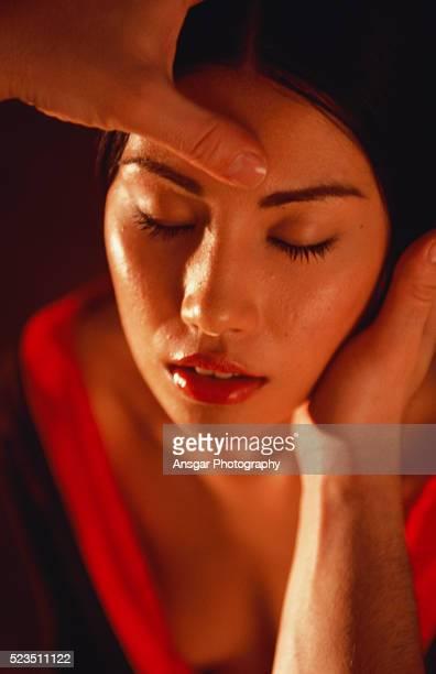 young woman receiving a massage - massaggio sensuale foto e immagini stock