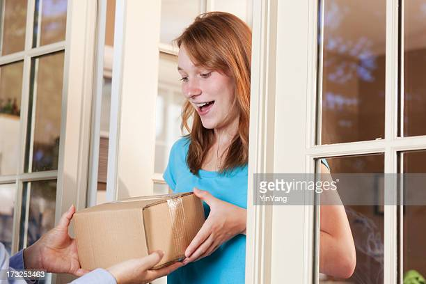 Young Woman Receiving a Package from Delivery Service Hz
