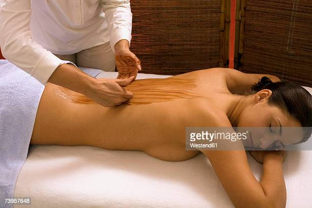 Young woman receiving ayurvedic treatment, eyes closed