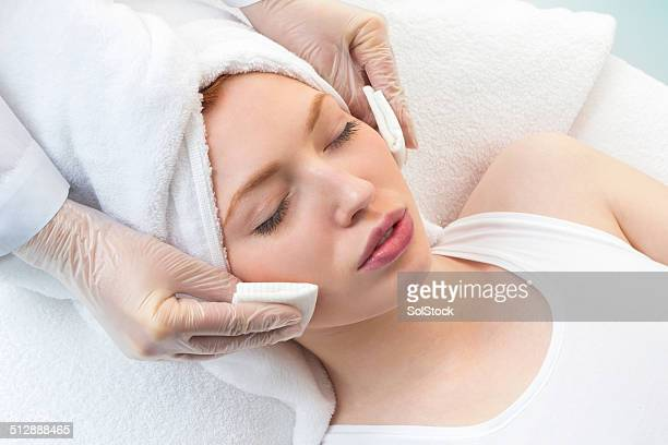 Young Woman Receiving Beauty Treatment