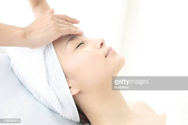 young woman receiving massage,woman in health spa