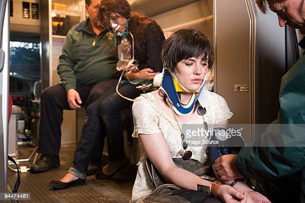 Young woman receiving medical attention