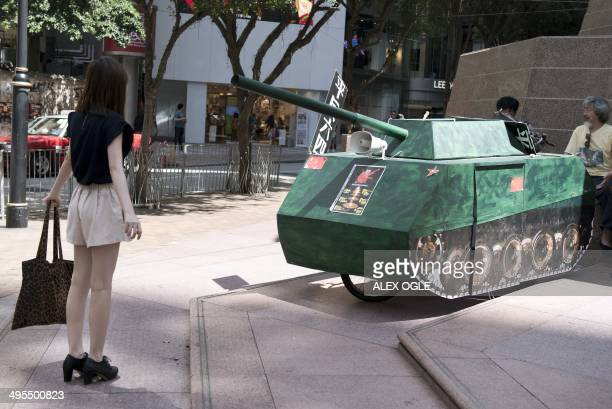A young woman reenacts the famous 'Tank Man' scene from the 1989 Tiananmen Square military crackdown on prodemocracy protesters om Beijing in front...
