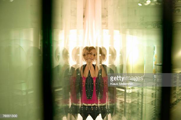 Young woman reflected in glass panes