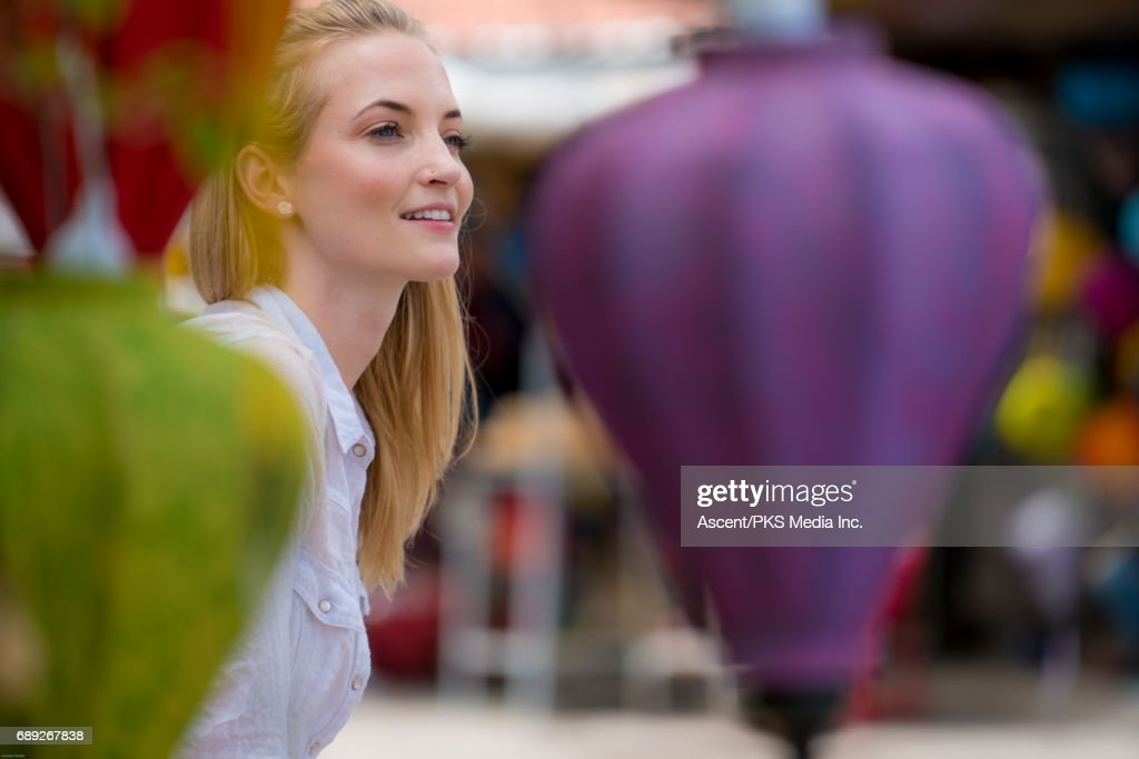 Young woman relaxes by Asian umbrellas : Stock Photo