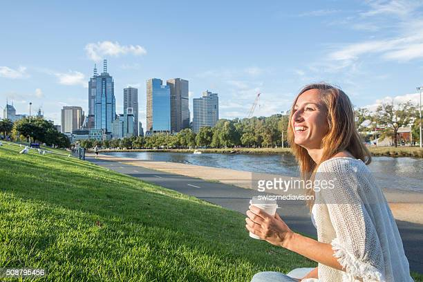 Young woman relaxing along the Yarra river in Melbourne, Australia