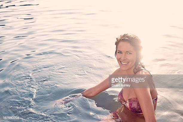 Young woman relaxing and swimming in water