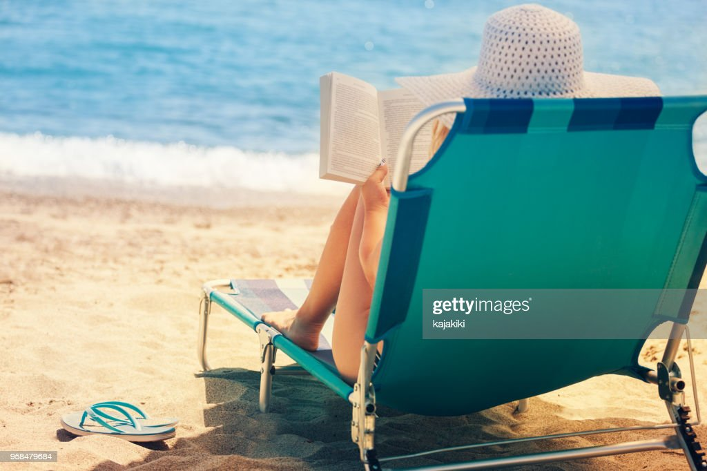 young woman relaxing at the beach stock photo getty images