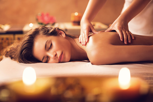 Young woman relaxing during back massage at the spa. 469916170