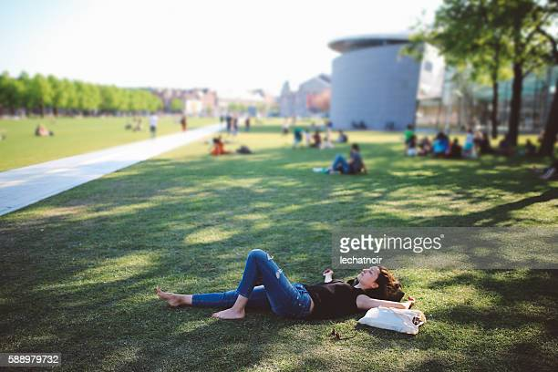 Young woman relaxing in Amsterdam city park