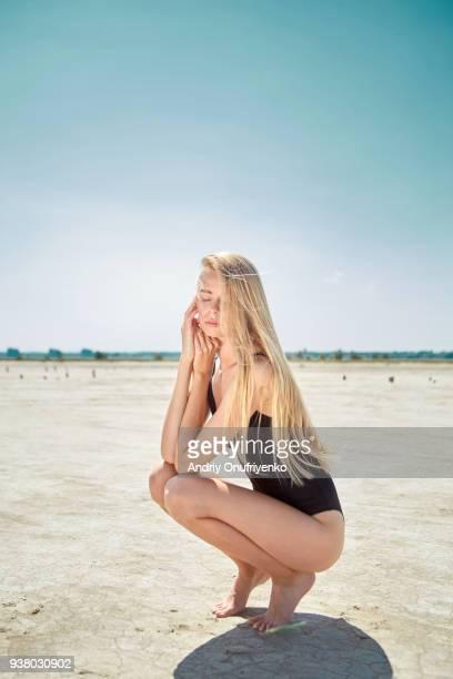 Young woman relaxing in desert