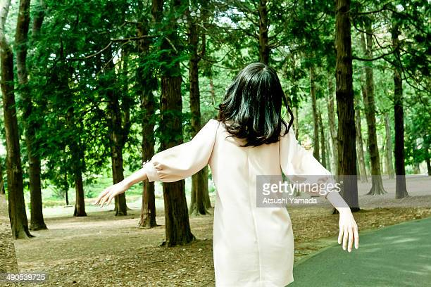 young woman relaxing in park,rear view - 袖 ストックフォトと画像