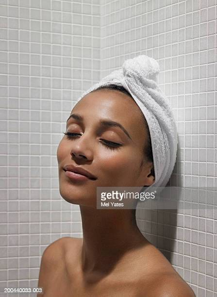 young woman relaxing in sauna, eyes closed, close-up - black woman in sauna stock pictures, royalty-free photos & images