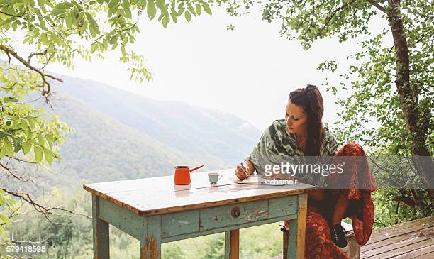 young woman relaxing in the beautiful nature - authors foto e immagini stock
