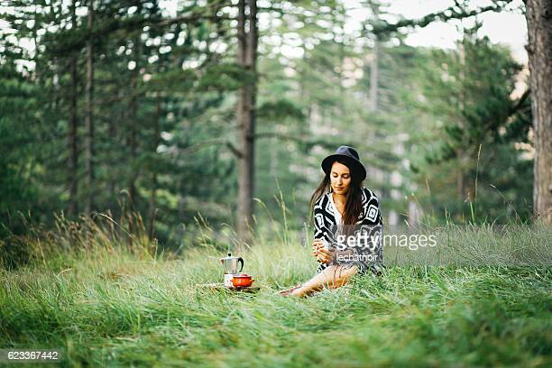 Young woman relaxing in the forest