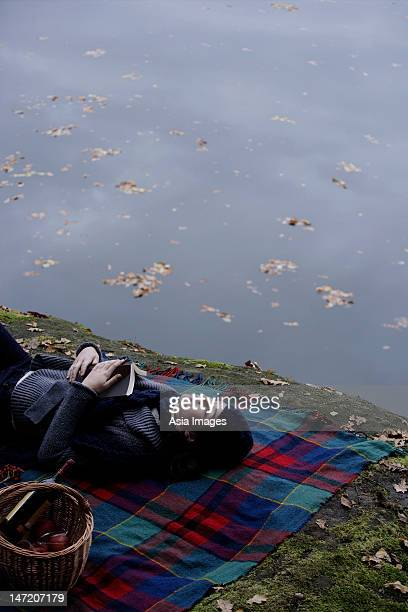 Young woman relaxing lakeside