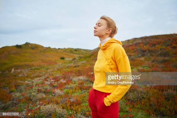 young woman relaxing near ocean - zen like stock pictures, royalty-free photos & images